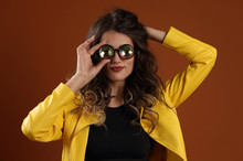 Beautiful Girl In A Yellow Jacket And Kaleidoscope Glasses