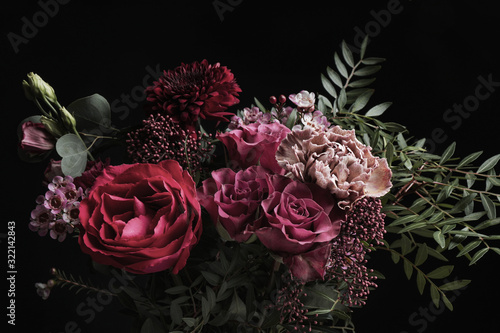 Foto Beautiful bouquet of different flowers on black background