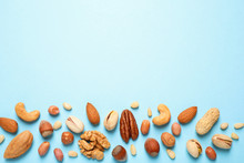 Different Delicious Nuts On Li...