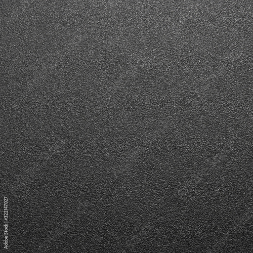 Black rough plastic.The texture is a rough matte plastic.The background is rough black plastic.