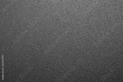 Obraz Black rough plastic.The texture is a rough matte plastic.The background is rough black plastic. - fototapety do salonu