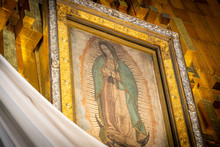 Our Lady Of Guadalupe With Mexican Flag In Mexico City