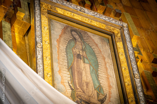 Our Lady of Guadalupe with mexican flag in Mexico City Fotobehang