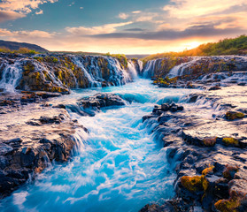 FototapetaSpectacular summer view of Bruarfoss Waterfall, secluded spot with cascading blue waters. Superb sunrise in Iceland, Europe. Beauty of nature concept background..