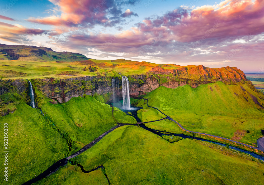 Fototapeta View from flying drone. Captivating summer view of Seljalandsfoss waterfall. Colorful sunrise in Iceland, Europe. Beauty of nature concept background.