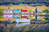 Colorful morning cityscape of small fishing town - Seydisfjordur. Calm summer scene of east west Iceland, Europe. Traveling concept background.