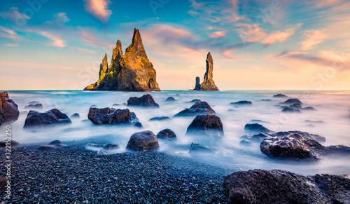 Obraz Breathtaking summer sunrise on Reynisdrangar cliffs in Atlantic ocean. Gorgeous morning scene of black sand beach in Iceland, Vik location, Europe. Beauty of nature concept background. - fototapety do salonu