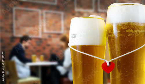 Photographie Two glasses of beer for lovers with red heart