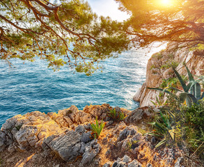 Fototapeta Morze Beautiful sunset above Adriatic sea and coastline in Makarska.