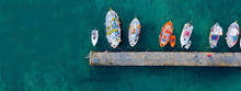 Aerial Drone Ultra Wide Photo Of Traditional Fishing Boat Docked In Old Port Of Mykonos Island, Cyclades, Greece