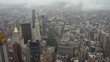 Top view of New York skyline in rainy and cloudy day. Skyscrapers of NYC in the fog. Stunning and magnificent view of famous city