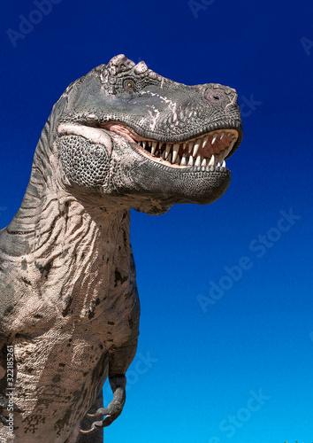 Obraz na plátně tyrannosaurus standing up alone on desert close up