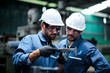canvas print picture - Two maintenance engineers discuss inspect relay checking information and protection system on a tablet computer in a factory. They work a heavy industry manufacturing factory.