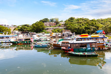 Fishing And Tour Boats Dock At The Busy Harbor In Sai Kung, Hong Kong, A Town Famous For Its Quaint Fishing Villages And The Floating Seafood Market