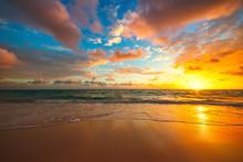 Beach Sunrise Over The Tropica...