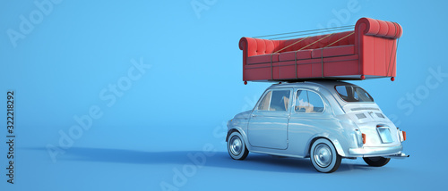 Fototapeta Small car with big sofa on the roof obraz