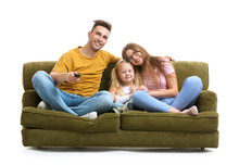 Happy Young Family Watching TV...