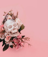 Skull With Flowers On Pink Background. Surreal Creative Concept. Artistic Magic Image. Close Up. Copy Space