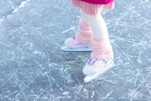 Child Ice Skating On Frozen Ri...