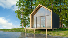 Wooden Secluded House In Scandinavian Modern Style With Large Windows Overlooking The Lake, Fireplace At Sunset Against A Background Of Coniferous Green Forest And Blue Sky. 3D Illustration