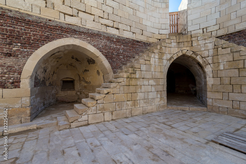 Exterior of ancient brick building with shabby stone stairway and two crumbling Canvas Print