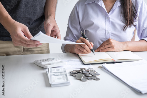 Fotografia, Obraz Images of Husband and wife using calculator to calculating expenditure receipt b