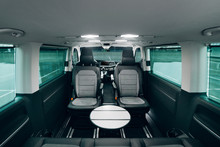 Interior Of Luxury Van With Comfortable Leather Seats And Table
