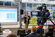 Still Camera Recording Male Speaker In Conference Hall