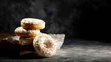 Fresh Sweet Donuts On Dark Bac...