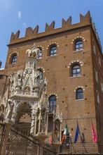Low Angle View Of Romeo's House Surrounded By Flags And Statues In Verona In Italy