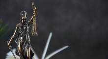 Law And Justice Symbols Over B...