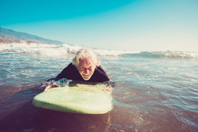 One Senior Trying Surfing Alon...