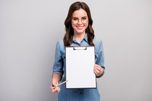Here. Photo Of Beautiful Wavy Business Lady Hold Clipboard Showing Contract Space For Signing Up Details Wear Specs Casual Jeans Denim Shirt Isolated Grey Color Background