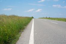 Straight Empty Asphalt Road An...