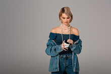 Attractive Woman In Denim Jacket Holding Insulated Mug Isolated On Grey