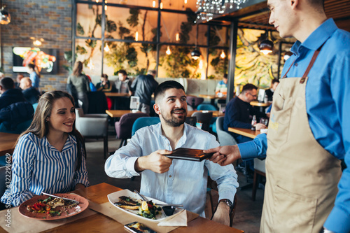Tablou Canvas couple in restaurant having lunch