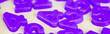 Leinwanddruck Bild - Panoramic shot of purple plastic numbers on white surface
