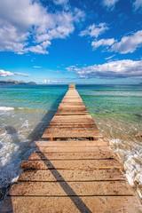 Fototapeta Morze sunny afternoon wintertime in playa de muro, mallorca, spain