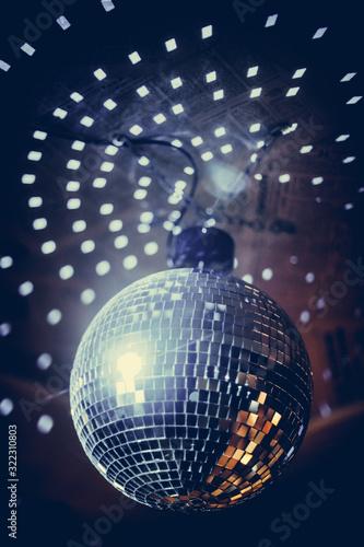 Shiny disco ball in a night club - 322310803