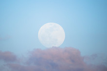 A Full Moon Softly Glows In A ...