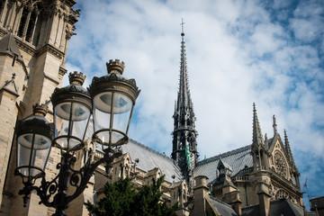 The burnt spire of Notre Dame de Paris color photo