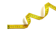 Yellow Measuring Tape Curls On A White Background Isolated. Tailor's Sewing Cloth Measuring Tool. Ruler For Body Measuring.