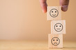 Hand select and putting smile cube emotion for stacking to normal and sad emotion wooden cubes.Excellent manage mindset and mood.