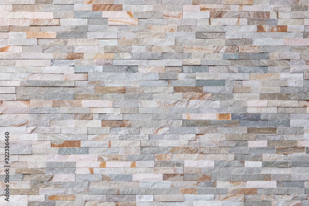 Stone wall pattern, decorative background texture. Light brown brick wall background for interior or exterior brick wall building and brick decoration texture.