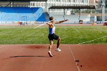 Javelin Throw Back Athlete Thrower In Track And Field Event