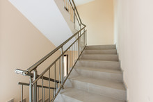 Modern Stair Case Between Floors. Stairs With Metallic Rail  In Modern Building