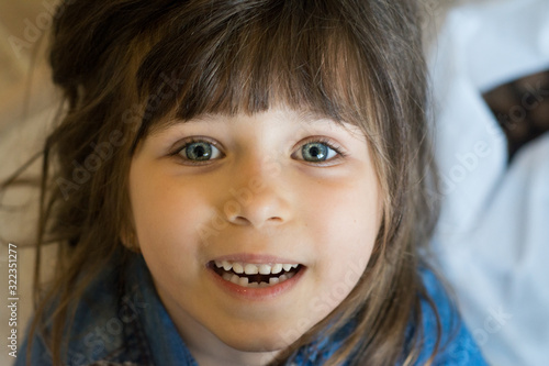 Cute 5 or 6 years toothless girl, milk teeth replaced with permanent teeth. The child dropped the first milk tooth
