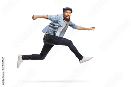 Bearded man in casual clothes jumping Fototapeta