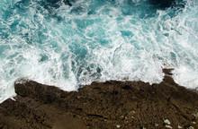Sea Waves And Rocks