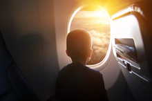Boy In The Plane Looking Out The Window